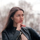Fashion beautiful brunette woman wearing a rock black leather Royalty Free Stock Images