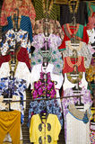 Fashion beautiful clothing hanging in asia street market bazaar Stock Photos