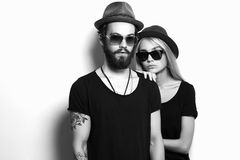 Fashion beautiful couple in hat together. Hipster boy and girl Royalty Free Stock Image