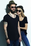 Fashion beautiful couple in hat together. Hipster boy and girl Stock Photos