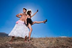 Fashion beautiful couple posing on mountains Stock Images