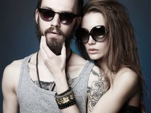Beautiful couple. bearded Hipster boy and girl. Fashion beautiful couple in sunglasses. bearded Hipster boy and beauty girl with tattoo Stock Images