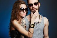 Fashion beautiful couple in sunglasses Stock Photography