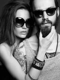 Fashion beautiful couple in sunglasses Royalty Free Stock Photos