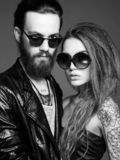 Fashion beautiful couple in sunglasses stock photos