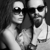 Fashion beautiful couple in sunglasses Stock Images