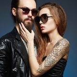Bearded man and tattoed girl in love royalty free stock image