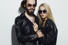Fashion beautiful couple together.Hipster boy and girl. Bearded young man and blonde in sunglasses Royalty Free Stock Photo