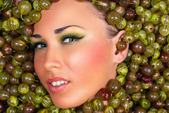 Fashion beautiful female face in gooseberry Royalty Free Stock Photo