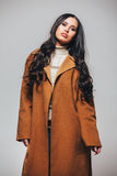 Fashion beautiful happy cute smiling brunette woman girl in casual brauwn coat Royalty Free Stock Photos