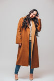 Fashion beautiful happy cute smiling brunette woman girl in casual brauwn coat Royalty Free Stock Photography