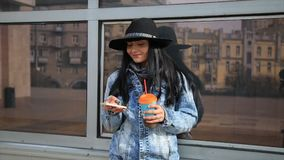 Fashion beautiful hispanic latina woman texting on smartphone in the city drinking latte coffee. Fashion beautiful hispanic latina woman texting on smartphone stock video footage