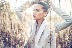 Fashion beautiful lady in autumn landscape Royalty Free Stock Photos