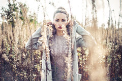Fashion beautiful lady in autumn landscape Stock Photo