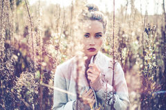 Fashion beautiful lady in autumn landscape Stock Image