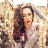 Fashion beautiful lady in autumn landscape Stock Photos
