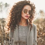 Fashion beautiful lady in autumn landscape Royalty Free Stock Photo