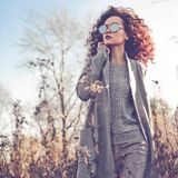 Fashion beautiful lady in autumn landscape Royalty Free Stock Images