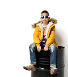 Fashion beautiful little boy in yellow winter clothing jacket je Stock Images