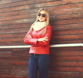 Fashion beautiful smiling woman wearing a red leather jacket Royalty Free Stock Photo