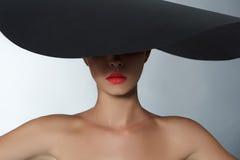Fashion beautiful woman in big hat. Fashion portrait of beautiful woman in big hat.Beauty girls face under hat.studio shot Royalty Free Stock Image