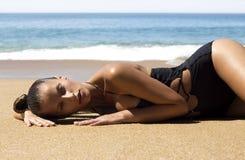 Fashion beautiful woman in bikini lying on beach Stock Photography
