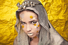 Fashion Beautiful Woman over grunge yellow background. Stock Photography