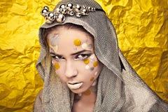 Fashion Beautiful Woman over grunge yellow background. Stock Photography