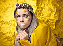 Fashion Beautiful Woman over grunge yellow background. Royalty Free Stock Photo