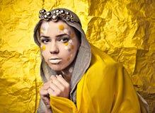 Fashion Beautiful Woman over grunge yellow background. Royalty Free Stock Photo