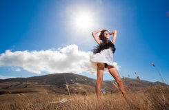 Fashion beautiful woman posing in the mountains Stock Images