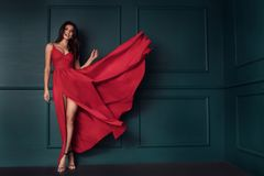 Fashion lady in red maxi dress stock photos