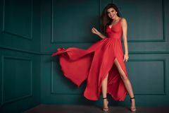 Fashion lady in red maxi dress royalty free stock photos