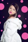 Fashion beautiful woman posing in white fur coat. Winter Girl Mo Royalty Free Stock Photo