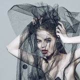 Fashion beautiful woman under the black veil Royalty Free Stock Images