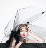 Fashion beautiful woman under the black veil Royalty Free Stock Image