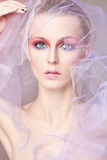Fashion beautiful woman under the veil Royalty Free Stock Image