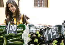 Fashion beautiful woman in vegetables market Stock Image