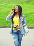 Fashion beautiful young african woman with retro vintage camera Royalty Free Stock Photography