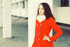 Fashion beautiful young woman wearing a red coat jacket and scarf in winter Stock Photo