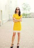 Fashion beautiful young woman wearing a yellow dress Stock Images