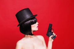 Fashion beautifull model with pistol in hat, on Stock Photos