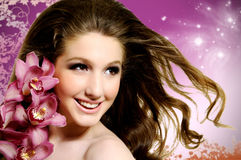 Fashion beauty. Portrait of woman with pink orchids Stock Photo