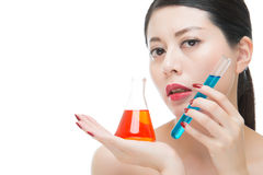 Fashion beauty asian woman mix chemistry makeup cosmetic liquid Stock Photography