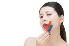Fashion beauty asian woman use chemistry cosmetic mixed liquid Royalty Free Stock Photography