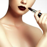 Fashion and beauty. Beautiful young woman with wine lipstick stock photography