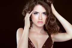 Fashion beauty brunette young woman model with wavy hair and mak Stock Image