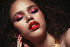Fashion and beauty concept: attractive african american woman closeup portrait. Fashion and beauty concept: attractive african american woman with bright make up stock photo