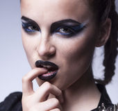 Fashion beauty. Creative woman make up, face-art Stock Image