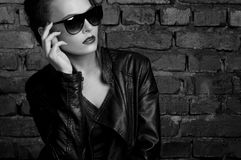 Fashion beauty girl in black leather jacket and sunglasses Stock Image